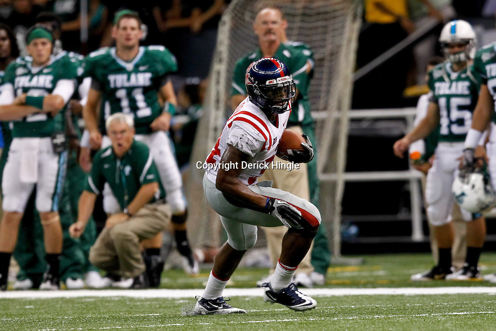 Sep 11, 2010; New Orleans, LA, USA; Mississippi Rebels running back Brandon Bolden (34) runs with the ball during a game against the Tulane Green Wave at the Louisiana Superdome. The Mississippi Rebels defeated the Tulane Green Wave 27-13.  Mandatory Credit: Derick E. Hingle