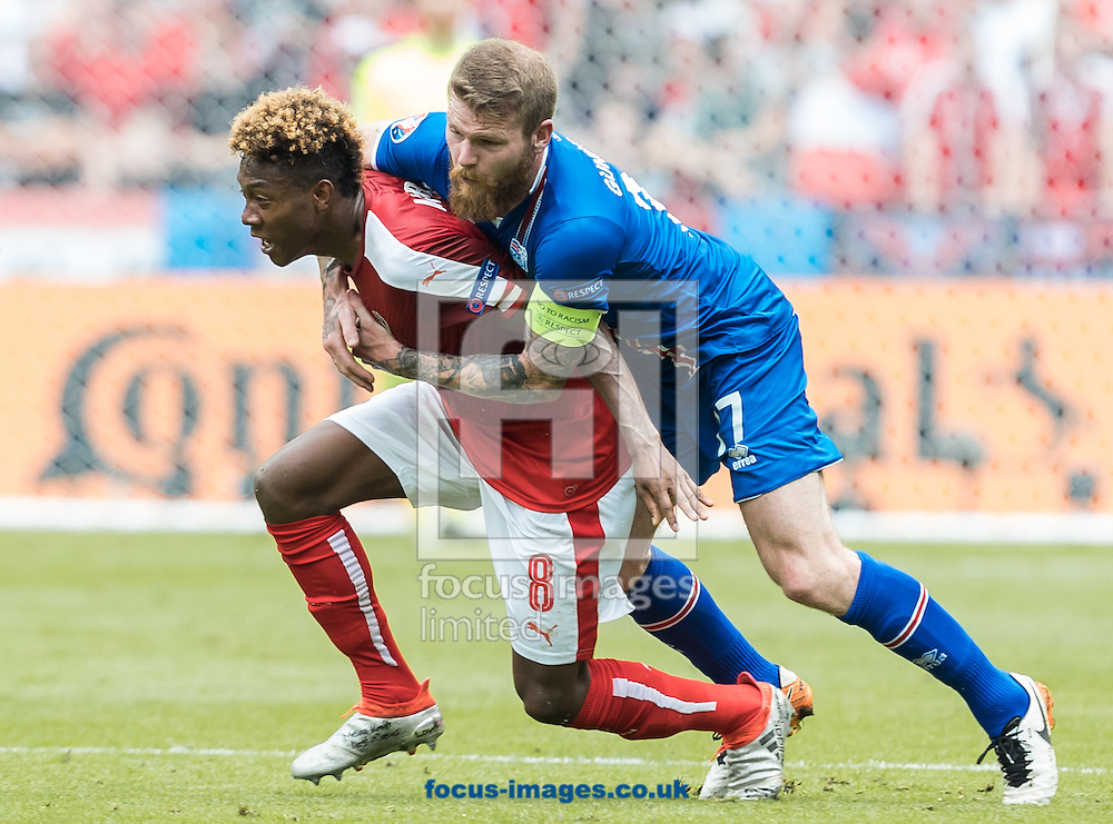 Johann Gudmundsson of Iceland and David Alaba of Austria during the UEFA Euro 2016 match at Stade Velodrome, Marseille, France.<br /> Picture by EXPA Pictures/Focus Images Ltd 07814482222<br /> 22/06/2016<br /> *** UK &amp; IRELAND ONLY ***<br /> EXPA-FEI-160622-5034.jpg