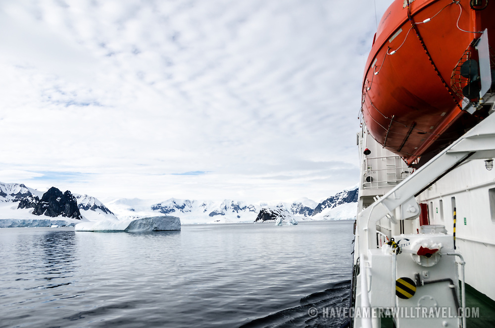 An Antarctic cruise ship motors toward Cuverville Island on the western side of the Antarctica Peninsula.