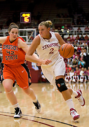 February 20, 2010; Stanford, CA, USA;  Stanford Cardinal forward/center Jayne Appel (2) dribbles past Oregon St. Beavers forward Anita Burdick (42) during the first half at Maples Pavilion.  Stanford defeated Oregon State 82-48.