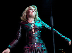 Kim Wilde steps out of the her TV Gardening clothes and Back on Stage to Tour with<br /><br />Steve Starnge (Visage)<br />Claire Grogan (Altered Images)<br />The Belle Stars<br />Dollar<br />Kim Wilde<br />The Human League<br />Play on the Here and Now  Christmas Party Tour at Sheffields Hallam FM Arena Friday 13th December 2002<br /><br />[#Beginning of Shooting Data Section]<br />Nikon D1 <br />2002/12/13 22:47:38.6<br />JPEG (8-bit) Fine<br />Image Size:  2000 x 1312<br />Color<br />Lens: 50mm f/1.8<br />Focal Length: 50mm<br />Exposure Mode: Manual<br />Metering Mode: Spot<br />1/200 sec - f/2.8<br />Exposure Comp.: 0 EV<br />Sensitivity: ISO 800<br />White Balance: Auto<br />AF Mode: AF-S<br />Tone Comp: Normal<br />Flash Sync Mode: Not Attached<br />Color Mode: <br />Hue Adjustment: <br />Sharpening: Normal<br />Noise Reduction: <br />Image Comment: <br />[#End of Shooting Data Section]