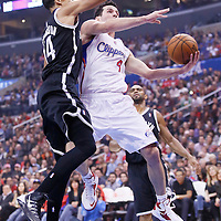 16 November 2013: Los Angeles Clippers shooting guard J.J. Redick (4) goes for the layup versus Brooklyn Nets point guard Shaun Livingston (14) during the Los Angeles Clippers 110-103 victory over the Brooklyn Nets at the Staples Center, Los Angeles, California, USA.