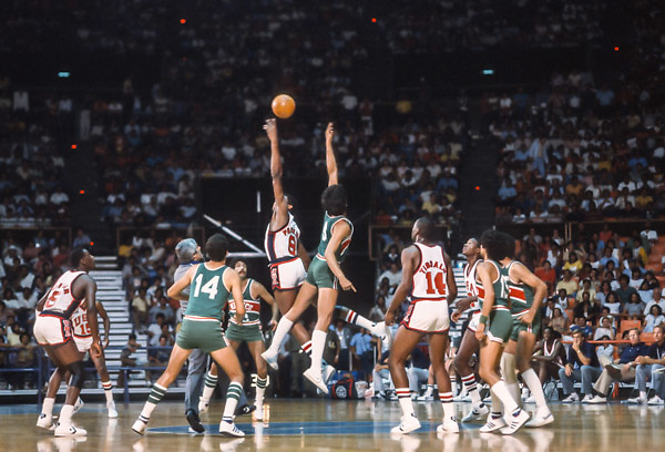 CARACAS, VENEZUELA -  AUGUST 1983:  Sam Perkins #8 (USA) leaps for a tip off in a game against Mexico during the 1983 Pan Am Games basketball tournament held from August 15-27, 1983 in Caracas, Venezuela.  Visible players include Michael Jordan #5 (USA) and Wayman Tisdale #14 (USA).  The USA team was the gold medalist in the event. (Photo by David Madison/Getty Images) *** Local Caption *** Michael Jordan;Sam Perkins