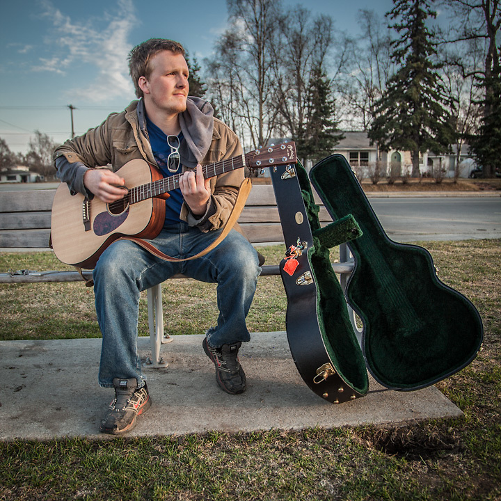 "Musician Ryan Noland with his guitar on the west end of the Delaney Park Strip, Anchorage.  ""For a long time I wanted to be a musician…now I want to start my own construction company…and make some money."" ranoland8@gmail.com"