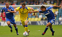 Photo: Frances Leader.<br />Millwall v Cardiff City. Coca Cola Championship.<br />24/09/2005.<br /><br />Cardiff's Jason Koumas runs with the ball between Millwall's Jermaine Wright and Phil Ifil
