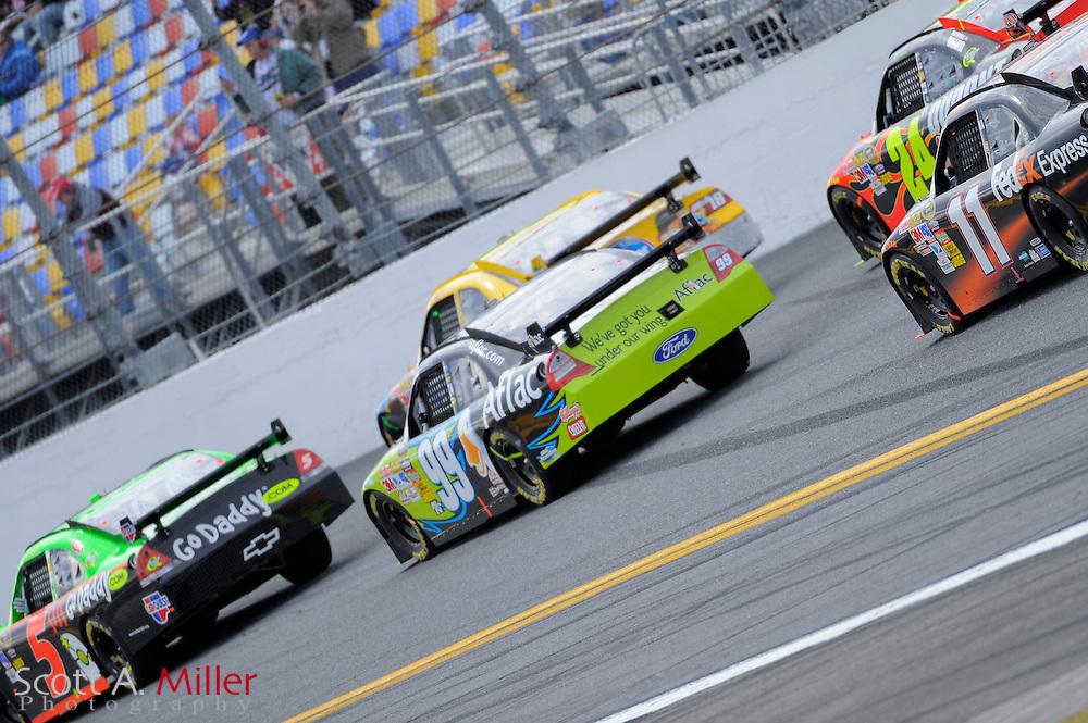 Feb. 11, 2010; Daytona Beach, FL, USA; NASCAR Sprint Cup Series driver Mark Martin (5) and Carl Edwards (99) lead a pack of cars through Turn 4 during race one of the Gatorade Duel at Daytona International Speedway. ©2010 Scott A. Miller