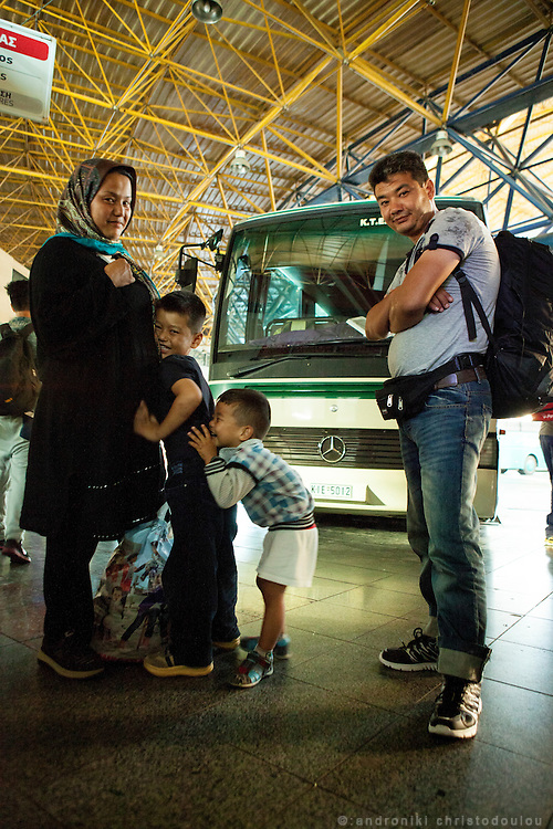 The Hassan family came from Kabul city in Afghanistan. They left the country because they had no work and no security. Their children are 2,5 and 5 years old and they have been travelling for 4 months. They crossed to Greece via Samos island. They now are waiting to board the bus to Eidomeni border. <br /> Refugees often arrive to Thessaloniki by train and then they go to the intercity bus station to board on the bus to Eidomeni border where they can cross to the Republic of Macedonia on foot.