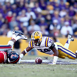November 17, 2012; Baton Rouge, LA, USA; LSU Tigers cornerback Tharold Simon (24) breaks up a pass to Ole Miss Rebels wide receiver Korvic Neat (28) during the first half of a game at Tiger Stadium.  Mandatory Credit: Derick E. Hingle-US PRESSWIRE