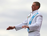 Drum Major Taylen Anderson directs the band during the Trojan Marching Band from South Tama Couty High School's performance at the State Marching Band Festival at Kingston Stadium in Cedar Rapids on Saturday October 6, 2012. Members of the band were wearing ribbons for Sabrina Betz and Ian McFate.