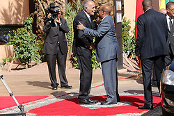 Morocco's Foreign Minister Salaheddine Mezouar (L) welcomes Sudanese President Omar al-Bashir upon his arrival at the Africa Action Summit, on the sidelines of the COP22 Climate Change Conference, on November 16, 2016 in Marrakesh, Morocco. Photo Alain Robert/ABACAPRESS.COM