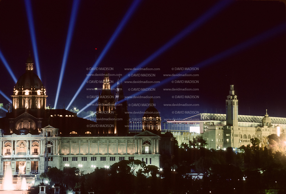 BARCELONA, SPAIN - AUGUST 9:  Spotlights illuminate the sky during the Closing Ceremony of the XXV Olympiad at the Montjuic Olympic Stadium (visible at upper right) on August 9, 1992.  Building in left foreground is the National Museum of Catalan Art.  (Photograph by David Madison/Getty Images) *** Local Caption ***