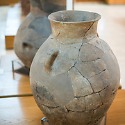 Large baked clay jar from Troy dating to 2100-1900 BC on display in the main building of the Istanbul Archaeology Museums. The Istanbul Archaeology Museums, housed in three buildings in what was originally the gardens of the Topkapi Palace in Istanbul, Turkey, holds over 1 million artifacts relating to Islamic art, historical archeology of the Middle East and Europe (as well as Turkey), and a building devoted to the ancient orient.
