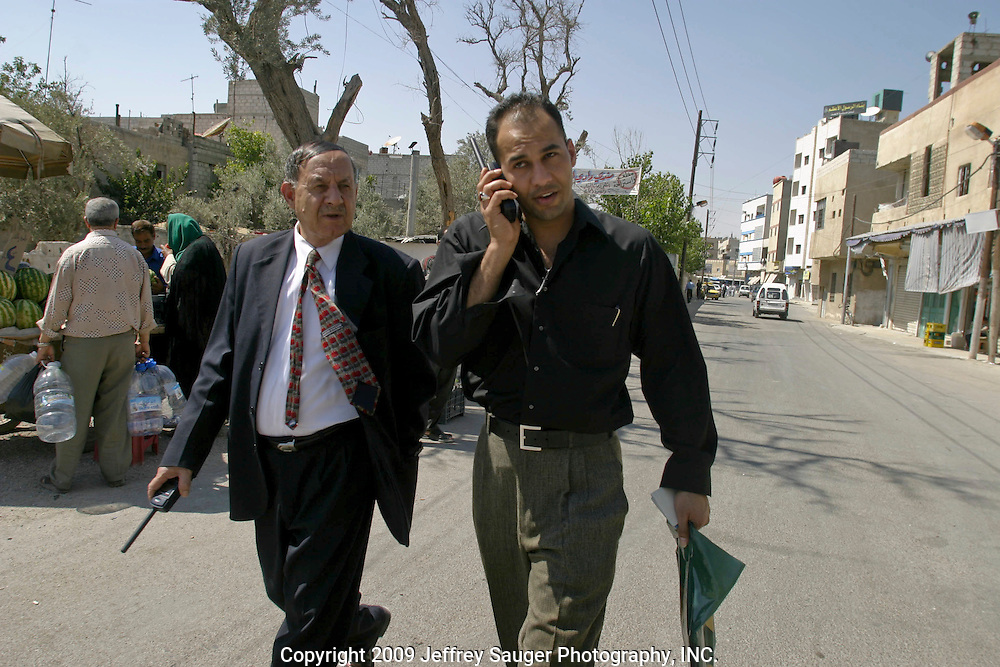 Emad Al-kasid and his father Malik Al-kasid, leave the family's apartment in the Iraqi area of Damascus, Syria, Wednesday, July 16, 2003. Emad hasn't seen his father in six months. Al-kasid has been planning has been planning the trip home to Nasiriyah, Iraq, over the last year. He is visiting his immediate family is in Damascus, Syria, as hundreds of thousands of Iraqi Shiite settled in Syria after the Gulf War and their uprising against Saddam Hussein in 1991.