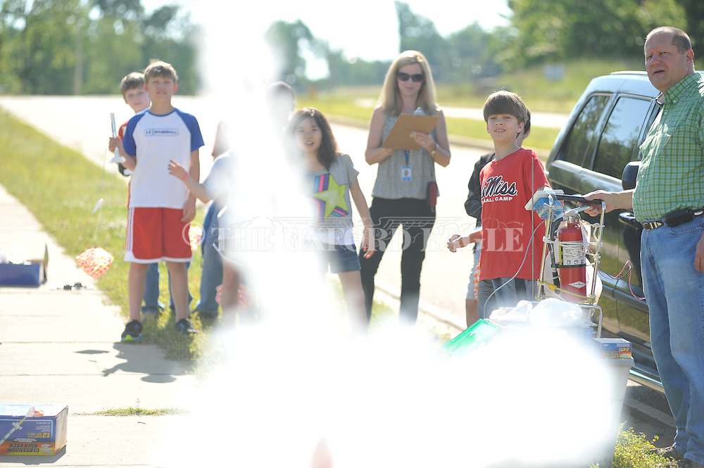 Downing Koestler launches a rocket at Della Davidson Elementary in Oxford, Miss. on Wednesday, May 8, 2013.