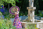 A floral dress made of 1,000 Orchida Vanda petals reflects the theme of M&G's own garden at this year's Show - a contemporary paradise garden.  2014 marks the fifth year M&G Investments have been the title sponsor of the RHS Chelsea Flower Show.   This year's M&G garden is designed by award-winning landscape designer Cleve West. The model's dress - created by Knightsbridge-based floral designer Judith Blacklock and showcased by model Nina Schubert - took over 50 hours to create.  The Chelsea Flower Show 2014. The Royal Hospital, Chelsea, London, UK