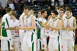 Uros Slokar (15) of Olimpija, Saso Ozbolt (31) of Olimpija, Sani Becirovic (7) of Olimpija and Jaka Klobucar (8) of Olimpija after Euroleague basketball match between KK Union Olimpija, Ljubljana and Maroussi B.C., Athens, on October 29, 2009, in Arena Tivoli, Ljubljana, Slovenia.  Olimpija lost 75:81. (Photo by Vid Ponikvar / Sportida)
