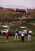Foursome golfing on fairway, Canyon hole #1, Westin La Paloma. ©1993Edward McCain. All rights reserved. McCain Photography, McCain Creative.
