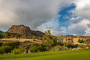 Landscape of amazing skies and clouds on a beautful stormy spring night at Blue Lakes Country Club House during sunset in the Snake River Canyon of Twin Falls, Idaho.
