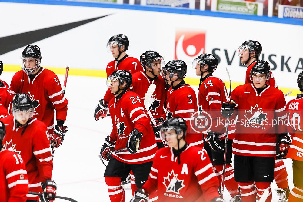 140104 Ishockey, JVM, Semifinal,  Kanada - Finland<br /> Icehockey, Junior World Cup, SF, Canada - Finland.<br /> Sad players in team Canada.<br /> Deppade spelare i det Kanadensiska laget.<br /> Endast f&ouml;r redaktionellt bruk.<br /> Editorial use only.<br /> &copy; Daniel Malmberg/Jkpg sports photo