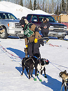Matt Groth of Grand Marais, MN, prepares for his ten-dog class sled race on Sunday, 2 Feb 2014. Scenes from the Apostle Islands Sled Dog Race, hosted by the Bayfield Chamber of Commerce, near Bayfield, WI
