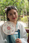Chinese woman in traditional Chinese clothes. Photographed in Chengdu, Sichuan, China