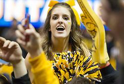 West Virginia cheerleaders react after beating Kansas at the WVU Coliseum.