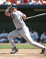 New York Yankee Tino Martinez hits a drive to left field against the Kansas City Royals at Kauffman Stadium in Kansas City, Missouri on August 4, 1996