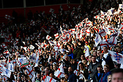 Fans waving England flags before the FIFA Women's World Cup UEFA Qualifier match between England Ladies and Wales Women at the St Mary's Stadium, Southampton, England on 6 April 2018. Picture by Graham Hunt.