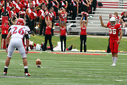 01 September 2012:  Ben Welsh watches Nick Aussieker put the ball in play during an NCAA football game between the Dayton Flyers and the Illinois State Redbirds at Hancock Stadium in Normal IL
