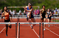 9 APRIL 2011 -- UNIVERSITY CITY, Mo. -- Washington HIgh School runner Haley Ulsas (center) crosses the final hurdle en route to the finish line during the girls' 300 meter hurdles at the Charlie Beck Invitational track meet at University City High School in University City, Mo. Saturday, April 9, 2011. Ulsas won the event. Image (c) copyright 2011 Sid Hastings.