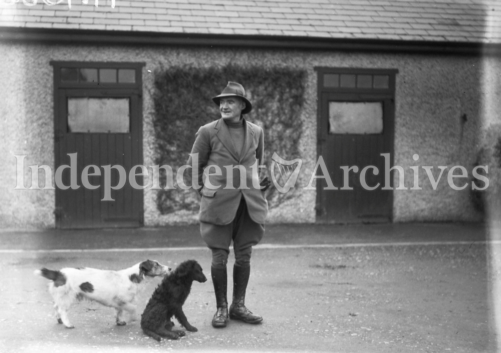H1566 Stud Farm - Cloghran. Man with dogs. 26/2/31. (Part of the Independent Ireland Newspapers/NLI Collection)