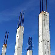 Reinforced concrete structural columns at a construction site where worked had been stopped due to the current economic slowdown. The site is the proposed Esperanza high rise site on the Asbury Park waterfront that went into foreclosure in December 2007. The site was recently purchased in September 2011 by Asbury Partners, the city's waterfront developer. Asbury Park, New Jersey, USA.