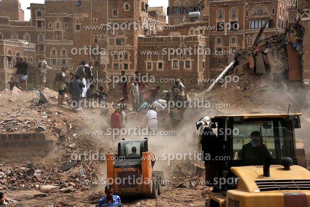 People search survivors after the air strikes in the Old City of Sanaa, in Sanaa, Yemen, on June 12, 2015. Warplanes of the Saudi-led coalition forces bombed a historical site inscribed on the UN World Heritage List in Yemen's capital Sanaa on Friday and killed at least six civilians. The Old City of Sanaa, situated in a mountain valley, has been inhabited for more than 2,500 years. In the seventh and eighth centuries, the city became a major center for the propagation of Islam, comprising 103 mosques, 14 hammams and over 6,000 houses, all built before the eleventh century. It was inscribed on the UNESCO World Heritage List in 1986. EXPA Pictures &copy; 2015, PhotoCredit: EXPA/ Photoshot/ Hani Ali<br /> <br /> *****ATTENTION - for AUT, SLO, CRO, SRB, BIH, MAZ only*****
