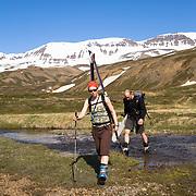 Helga Björt Möller and Óliver Hilmarsson on foot in Flateyjardalur, Iceland.