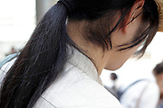 person with long black hair wearing in a pony tale