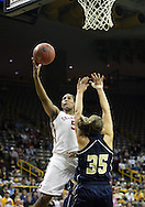24 MARCH 2009: Oklahoma forward/center Ashley Paris (5) puts up a shot over Georgia Tech forward Brigitte Ardossi (35) during an NCAA Women's Tournament basketball game Tuesday, March 24, 2009, at Carver-Hawkeye Arena in Iowa City, Iowa. Oklahoma defeated Georgia Tech 69-50.