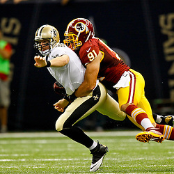 September 9, 2012; New Orleans, LA, USA; New Orleans Saints quarterback Drew Brees (9) gets rid of the ball as Washington Redskins linebacker Ryan Kerrigan (91) applies a hit during the second half of a game at the Mercedes-Benz Superdome. The Redskins defeated the Saints 40-32. Mandatory Credit: Derick E. Hingle-US PRESSWIRE