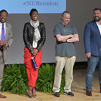 Famous alumni form Northwestern University appear on stage during an alumni event at the Evanston campus.