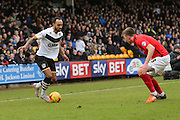 Port Vale forward Byron Moore  takes on Coventry City defender Chris Stokes  during the Sky Bet League 1 match between Port Vale and Coventry City at Vale Park, Burslem, England on 7 February 2016. Photo by Simon Davies.