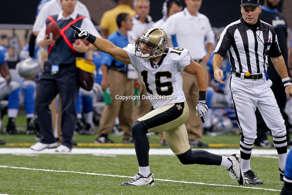 2009 September 13: New Orleans Saints wide receiver Lance Moore (16) signals first down after a reception during a 45-27 win by the New Orleans Saints over the Detroit Lions at the Louisiana Superdome in New Orleans, Louisiana.