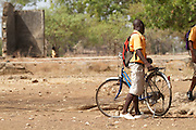 A boy leaves Tonga Junior High School on his bicycle.