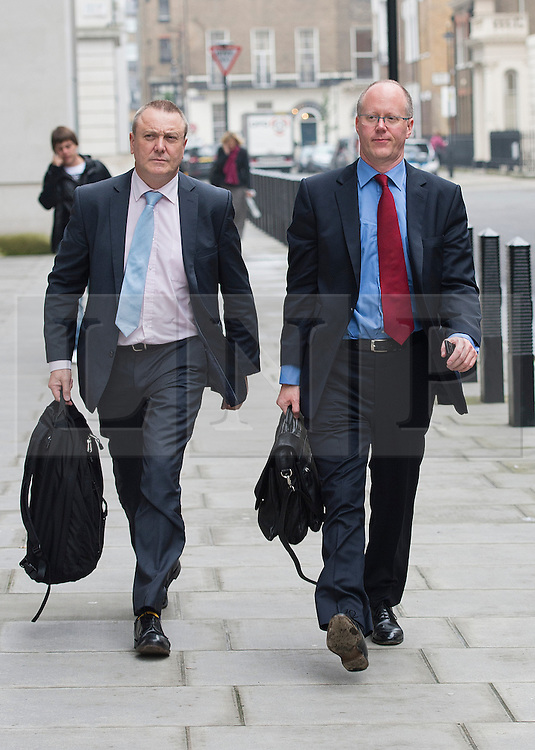 © London News Pictures. File picture dated 23/10/2012. London, UK.  Director General of the BBC George Entwistle (right) arriving at BBC Broadcasting House in London AFTER giving evidence to the Commons Culture Committee on the BBC's response to the Jimmy Savile affair. Photo credit: Ben Cawthra/LNP
