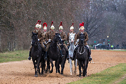 © Licensed to London News Pictures. 26/02/2018. London, UK. The Household Cavalry train on the bridlepath in Hyde Park as snow falls. Severe cold, blizzards and heavy snow are expected as the 'Beast from the East' brings freezing Siberian air to the UK. Photo credit: Rob Pinney/LNP