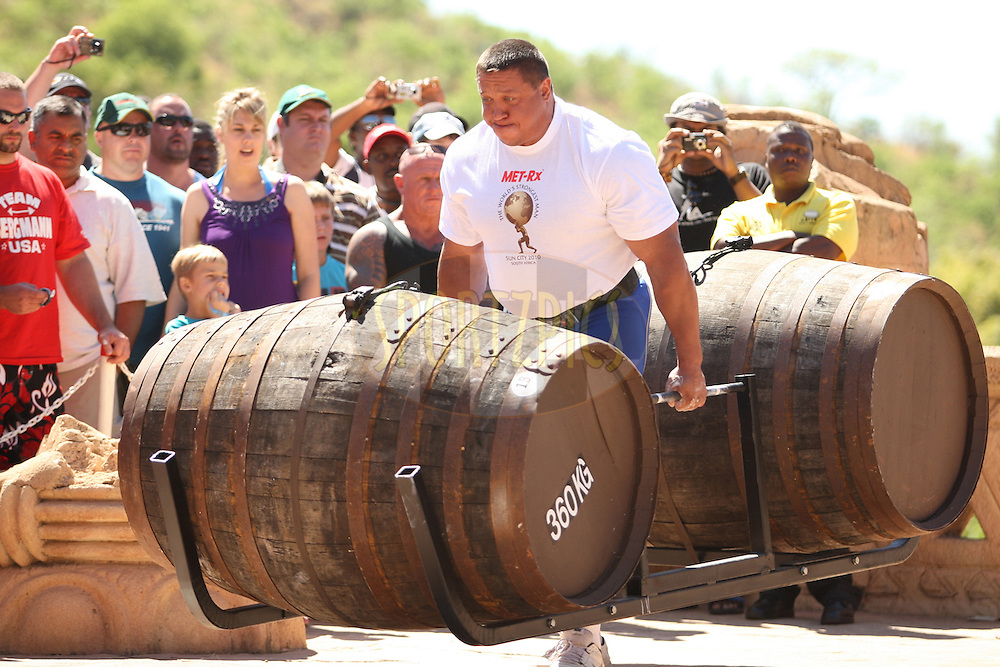 Mikhail Koklyaev (Russia) on his way in the whiskey-barrel walk during the final rounds of the World's Strongest Man competition held in Sun City, South Africa.
