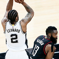 01 May 2017: San Antonio Spurs forward Kawhi Leonard (2) takes a jump shot over Houston Rockets guard James Harden (13) during the Houston Rockets 126-99 victory over the San Antonio Spurs, in game 1 of the Western Conference Semi Finals, at the AT&T Center, San Antonio, Texas, USA.