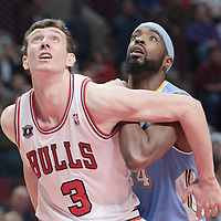 08 November 2010: Chicago Bulls' center #3 Omer Asik vies for a rebound with Denver Nuggets' center #34 Melvin Ely during the Chicago Bulls 94-92 victory over the Denver Nuggets at the United Center, in Chicago, Illinois, USA.