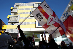 © Licensed to London News Pictures. 13/01/2012. London, U.K..EDL (English Defence Leage) march through Barking Town centre and hold a rally outside Barking Town Hall..Once the rally finished the majority of EDL supporters moved away by train, but small groups gathered in Pubs were confronted with anti fascist supporters. Small amount of arrests occurred due to clashes between EDL and the Anti Fascist supporters outside the Barking Dog Pub..Photo credit : Rich Bowen/LNP