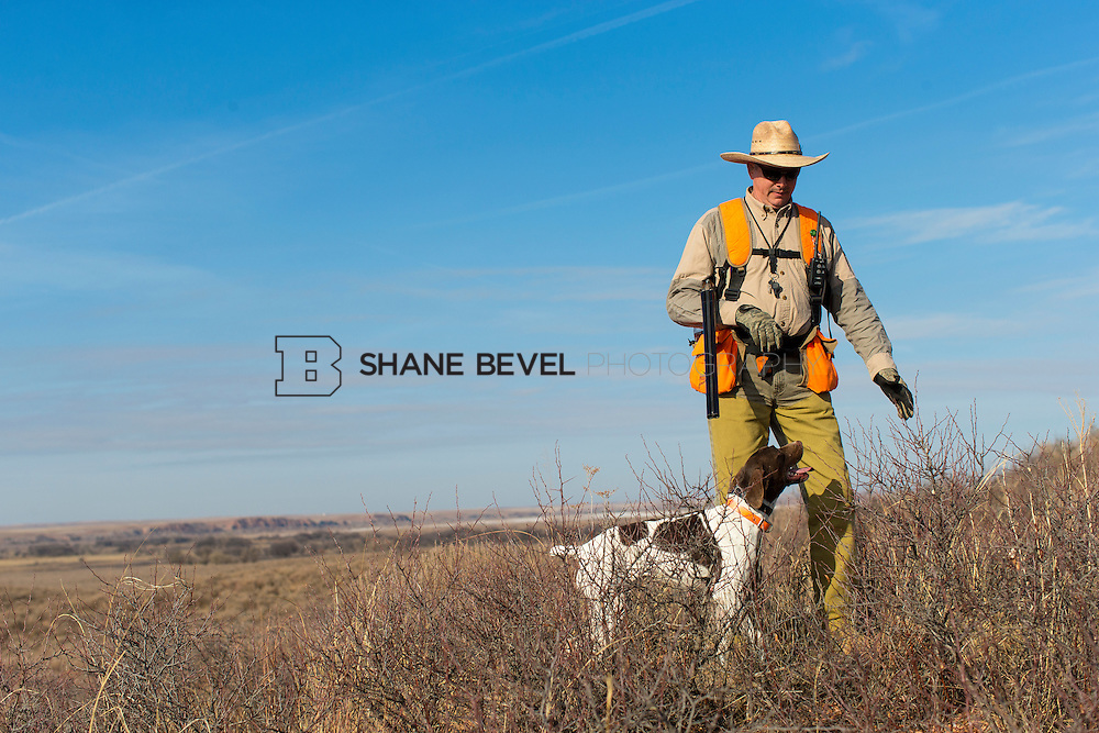 12/8/12 11:31:08 AM -- Quail hunting on the Cimarron Hills WMA in western Oklahoma. <br /> <br /> Photo by Shane Bevel