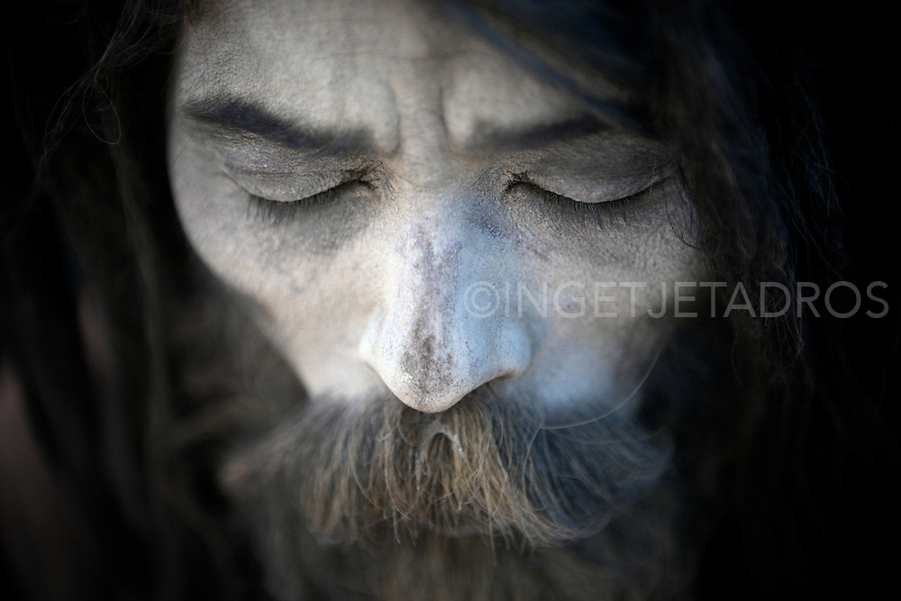 Baba Mehand Bidjegri is a Naga Sadhu, aged 43 yrs old.<br /> Born in Kolkata of the Atjaria Caste (Braham) which is a high caste, his father was a Sadhu and all male members in his family are Sadhus.<br /> Baba G as he calls himself is celebate and vowed to leave everything but mentioned he has no objection to alcohol and drugs.<br /> Baba G lives everywhere and has no belongings, he moves around all the time and as a child ( 9 yrs.) he did the 'childroute' and lived in various Ashrams where he learned to read and write while his family supported him.<br /> The only thing he always carrys with him is a plastic bag with Babud (human ashes) which he rubs over his whole body to protect him from the cold.<br /> <br /> In Hinduism, Sadhu means a good man, a holy man, a wondering monk.<br /> Most Sadhus are yogi's but not all yogi's are Sadhus<br /> The Sadhu is solely dedicated to achieving liberation, the fourth and final 'asrama' (stage of life), through meditation and contemplation.<br /> Sadhus often wear saffron-colored clothing, symbolizing their 'sanyasa' (reincarnation) &copy;Ingetje Tadros