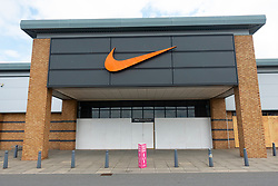 Edinburgh, Scotland, UK. 19 June, 2020. Several shops at Straiton Retail Park outside Edinburgh have opened. Signage warning customers to maintain 2m social distancing is positioned outside and inside shops. Nike factory store remains closed and boarded up. Iain Masterton/Alamy Live News